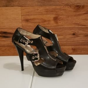 Black leather heel with silver zipper